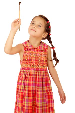 Little girl with a paintbrush, front view, isolated on white photo