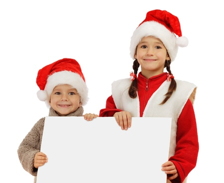 Little children in Christmas hats with an empty banner in hands, isolated on white photo