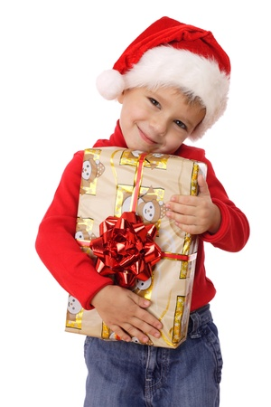 Smiling little boy with yellow Christmas gift box photo
