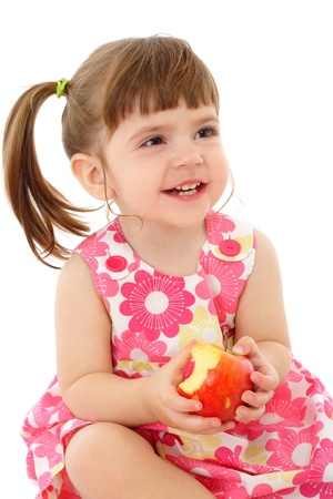 infant girl: Smiling little girl with apple, isolated on white