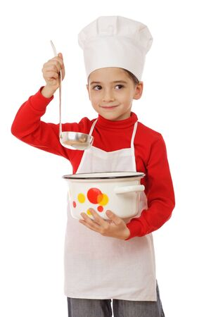 Smiling little chief-cooker with ladle and pot, isolated on white photo