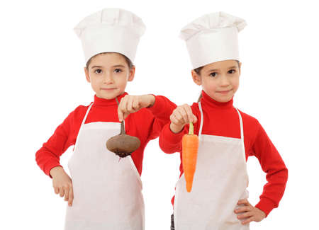 Two little chief-cookers holding a vegetables, isolated on white Stock Photo - 9369372