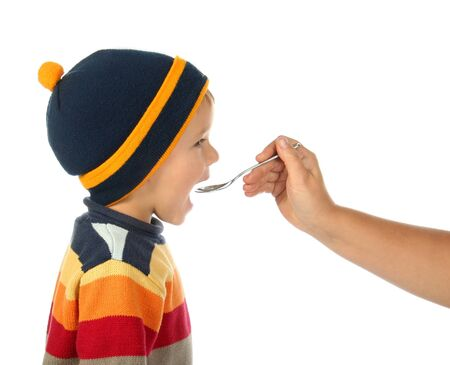 wolly: little open-mouthed boy in the sweater with spoon held by the adult persons hand