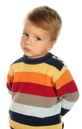 dirty blond: Confused little boy in sweater with cake-dirty face