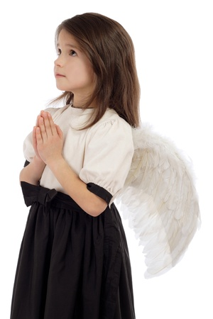 Little girl with angel wings, isolated on white photo