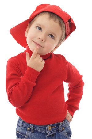 think about: Smiling little boy in red hat thinking about, isolated on white