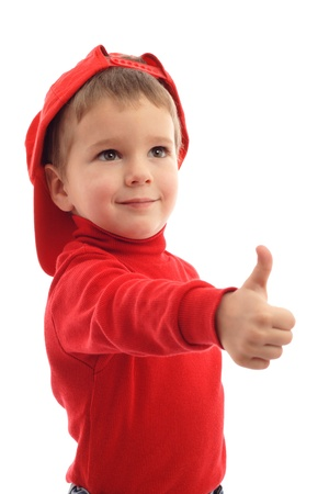 Little boy in red hat with thumb up sign, isolated on white photo