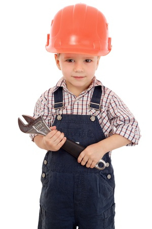 Little builder in coveralls and helmet with wrench, isolated on white Stock Photo - 9436783