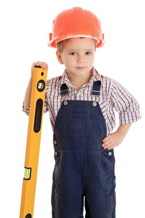 Little builder in coveralls and helmet with liquid level, isolated on white Stock Photo - 9467748