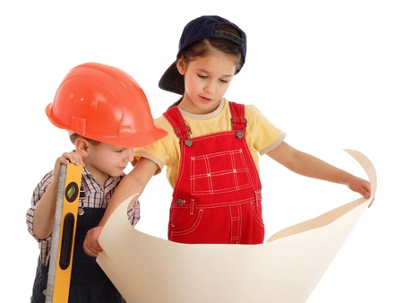 construction level: Two little builders with liquid level and blueprint, isolated on white