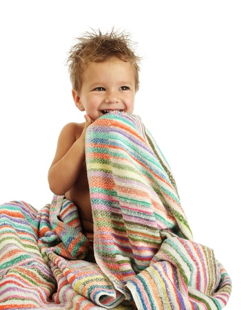Smiling little boy in towel photo