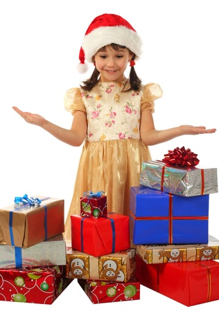 Smiling little girl with lot Christmas gift boxes photo