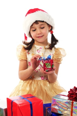 Smiling little girl with Christmas gift box photo