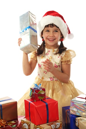 Smiling little girl with Christmas gift boxes Stock Photo - 9616813