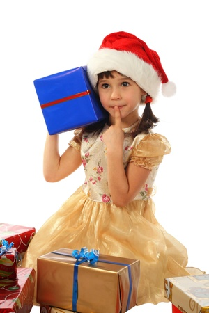 Smiling little girl with Christmas gift boxes photo