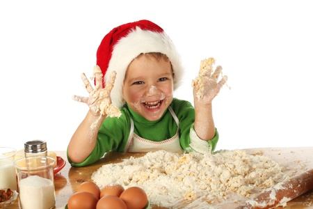 Little boy cooking the Christmas cake Stock Photo