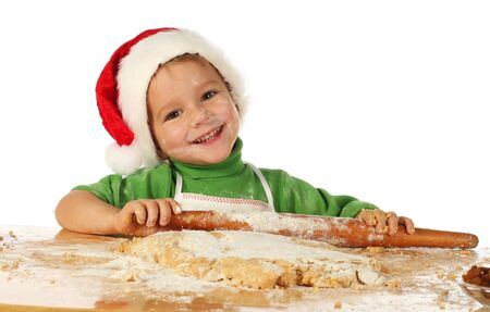 Little boy cooking the Christmas cake photo