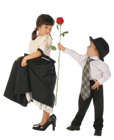 Little boy and girl with red rose photo