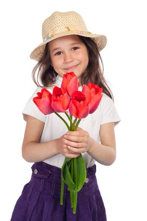 spring hat: Little girl in straw holding red tulips