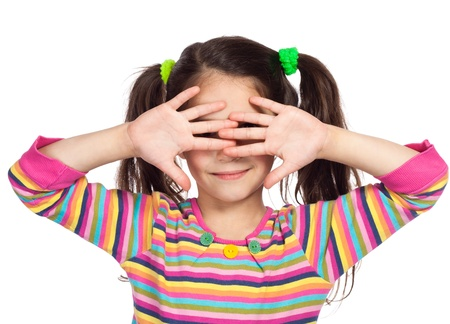eye  closed: Smiling little girl covered his eyes with his hands and peep through fingers Stock Photo
