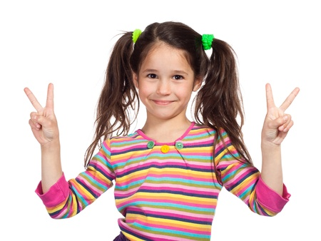 victory sign: Little girl showing two hands with victory gesture Stock Photo