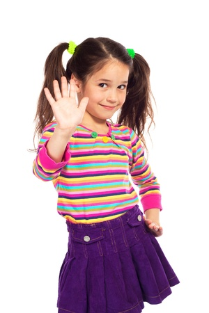Smiling little girl showing her hand up, isolated on white