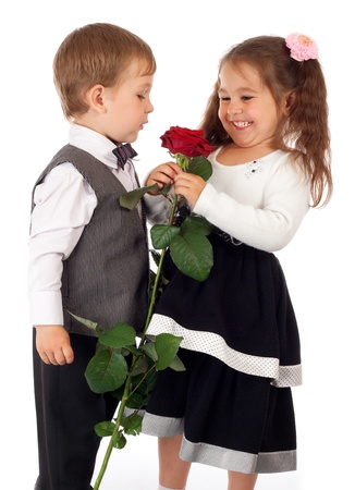 Smiling little girl with boy and red rose Stock Photo - 10000482