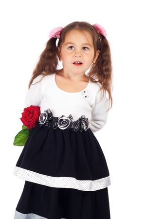 Smiling little girl hiding red rose Stock Photo - 10000464