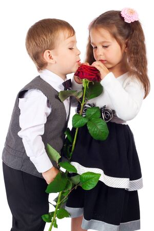 little boy and girl: Little girl with boy and red rose
