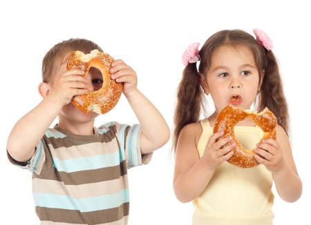 Two little children eating bagels Stock Photo - 10000498