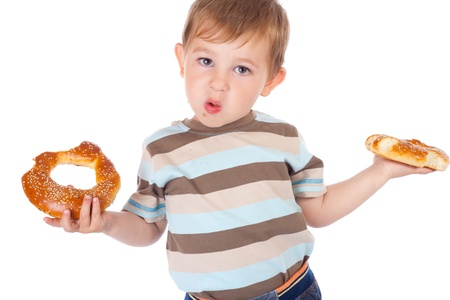 Little stained boy eating two bagels photo