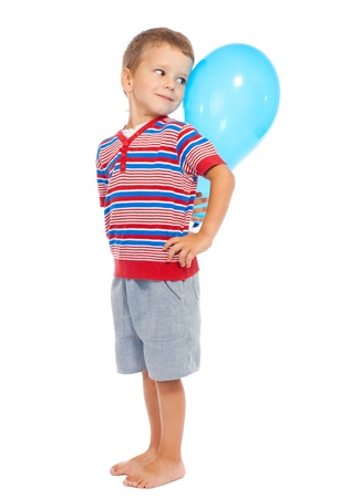 Smiling little boy with blue balloon, isolated on white