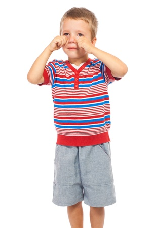 Crying standing little boy, isolated on white