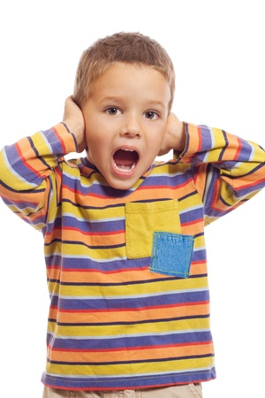 hearing protection: Little boy closing ears with his hands, isolated on white Stock Photo