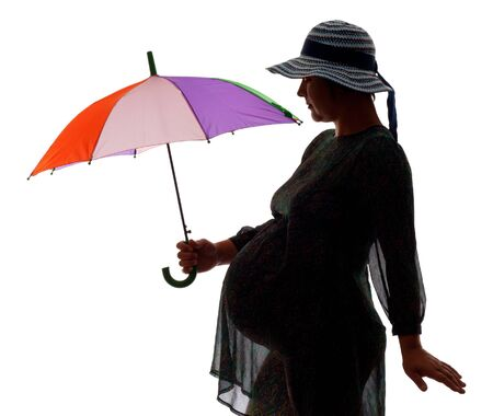 Silhouette of pregnant women with color umbrella, isolated on white photo