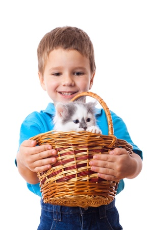 elementary age boys: Smiling little boy with kitty in wicker, isolated on white