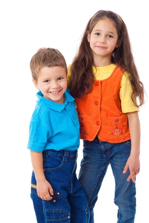 elementary age girl: Two smiling little children standing together, isolated on white Stock Photo