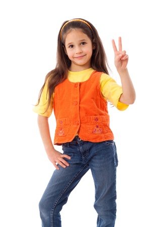 victory stand: Smiling little girl showing victory gesture, isolated on white