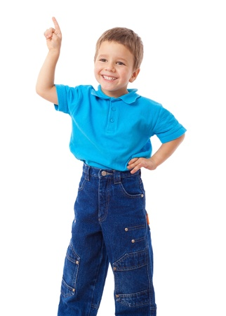 Smiling little boy with empty pointing hand, isolated on white