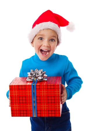 Laughing little boy in Santa photo