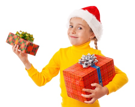 Smiling girl in Santa hat with two gift boxes, isolated on white photo