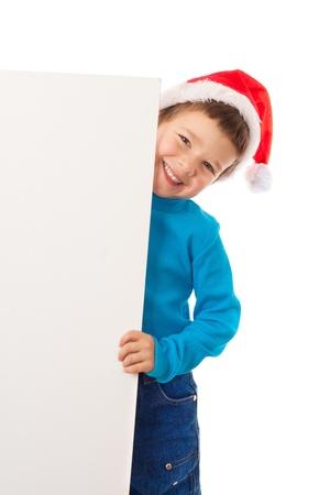 Smiling little boy in Santa photo