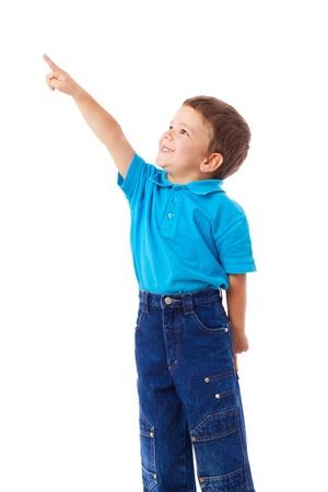 niÑos contentos: Niño con vacío apuntando levantó la mano, aislados en blanco Foto de archivo