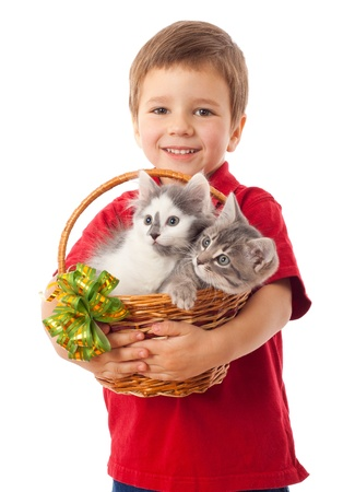 Little boy with  two kittens in basket, isolated on white