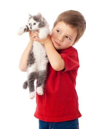Little boy with kitten in hands, isolated on white Imagens
