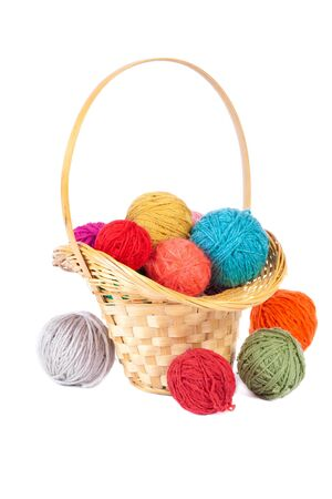 Basket with colorful balls of yarn, isolated on white photo