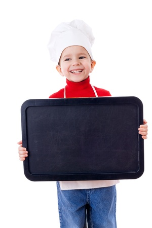 Smiling little cooker with empty horizontal chalkboard, isolated on white photo