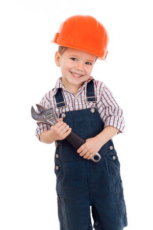 mechanics: Little builder in coveralls and helmet with wrench, isolated on white