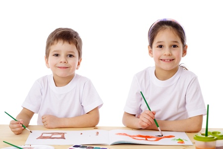 Two little kids at the table draw with watercolor, isolated on white Stock Photo - 12353552