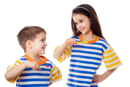 Smiling kids brushing teeth, isolated on white